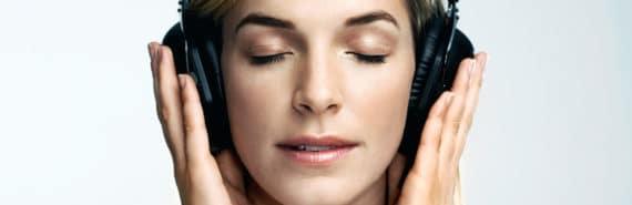 woman wears headphones