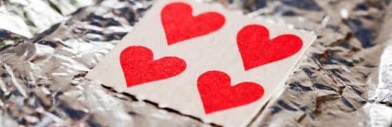 heart-shaped LSD tabs on tin foil