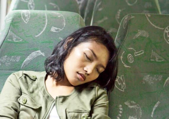 woman naps on bus
