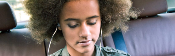 teen girl in backseat of car
