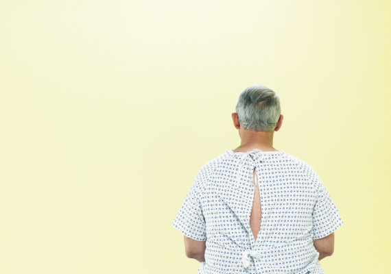 older man in hospital gown