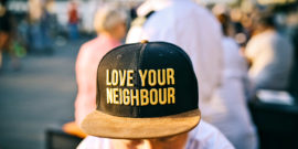 "hat says ""love your neighbor"""