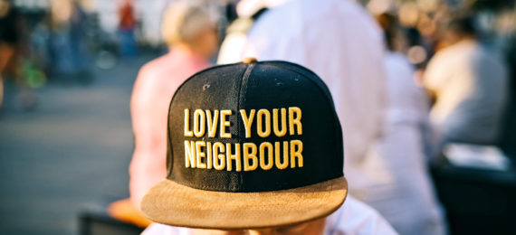 """hat says """"love your neighbor"""""""