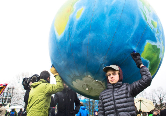 Paris Agreement protest with globe