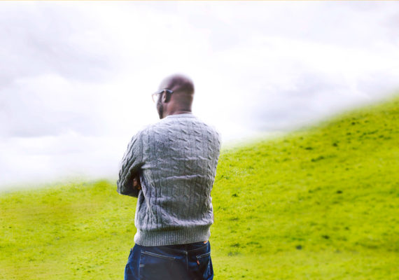 man stands between green and white