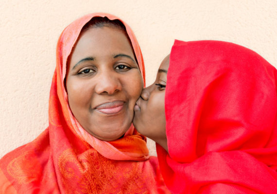 muslim mom and daughter in red