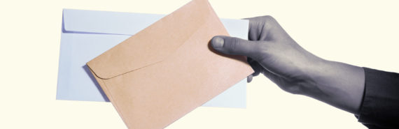 hand holding out envelopes