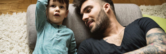 toddler and dad lie on floor