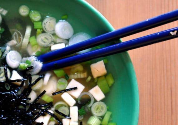 soup with tofu and chopsticks