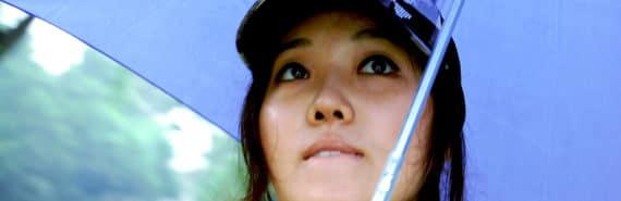 woman under a blue umbrella