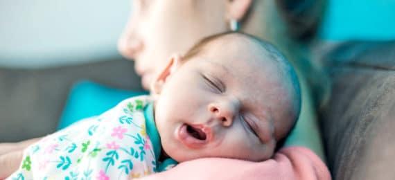 newborn baby on mom's shoulder