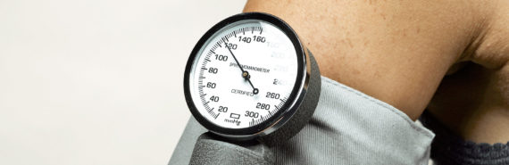 blood pressure cuff on arm