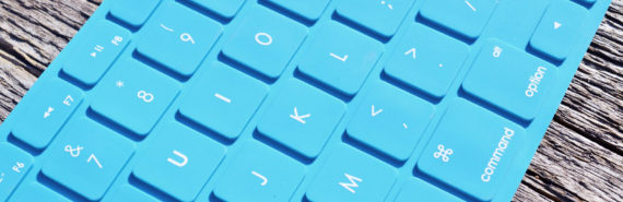 blue keyboard on wood