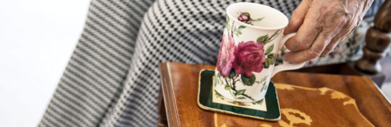 woman holds floral coffee cup