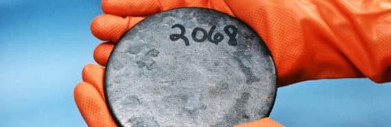 enriched uranium in orange gloves