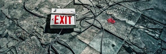 exit sign on abandoned building floor