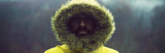 man in furry yellow hood