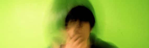 man sneezing on green