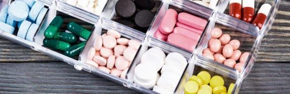 box of pills on wood table