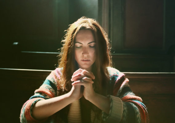 woman praying - religiosity