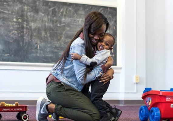 mother hugging smiling son