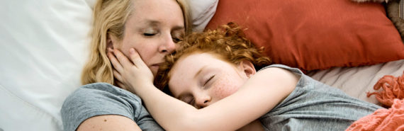 mother and daughter co-sleeping