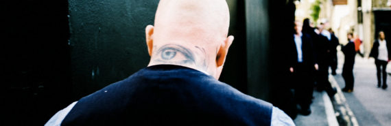 eye tattoo on man's neck