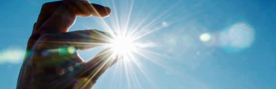 hand pinches sun
