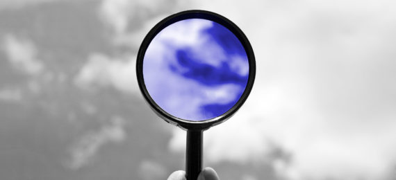 magnifying glass against sky