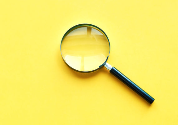 magnifying glass on yellow