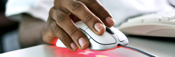 hand holds computer mouse