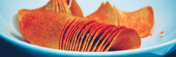 orange potato chips on a blue plate
