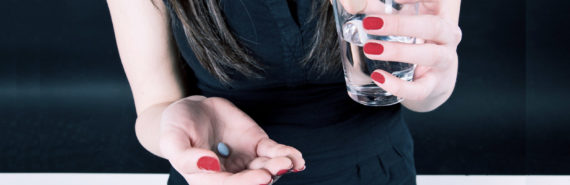 holding antidepressants and water