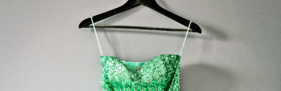 green sequin dress on hanger
