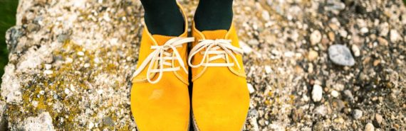 yellow shoes on a rock