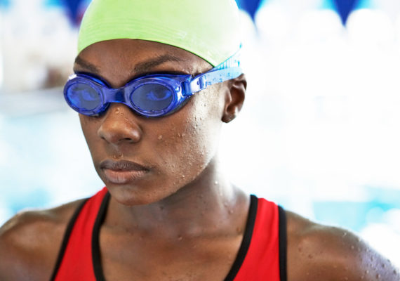 swimmer wearing blue goggles