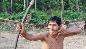 Tsimane man with bow and arrow