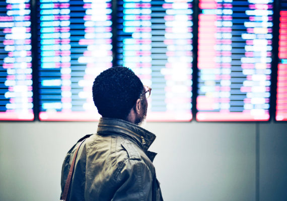 man checks flight times