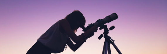 amateur astronomer with telescope