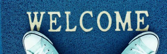 blue welcome mat with sneakers