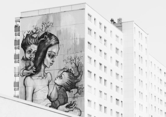 mural of mom and children on building