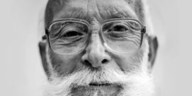 older man with glasses and beard