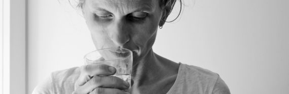 woman with glass in bw