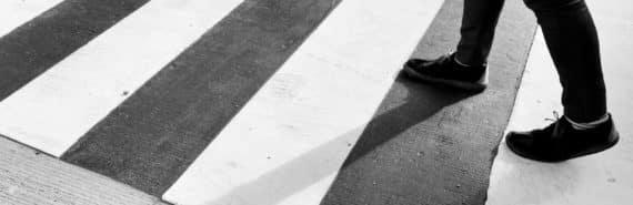 person walks on crosswalk