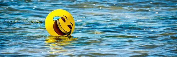 laughing emoji ball in water