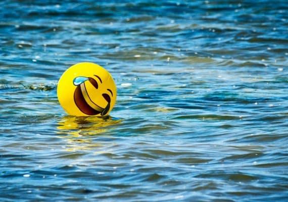 laughing emoji ball in water
