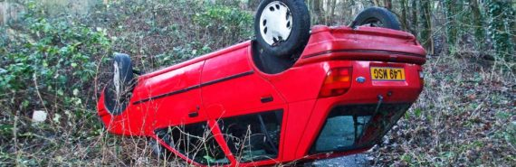 flipped red car