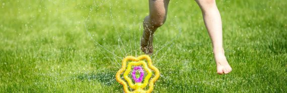 girl runs in sprinkler