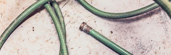 green hose on on concrete