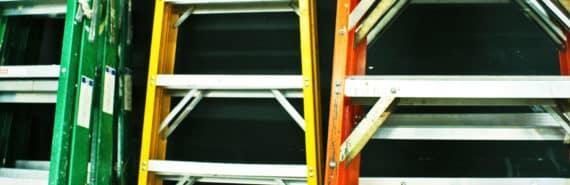 ladders against black wall